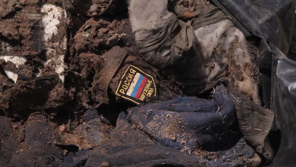 «Ополчение Новороссии»: наДонбассе отыскали  тела погибших сроссийскими шевронами